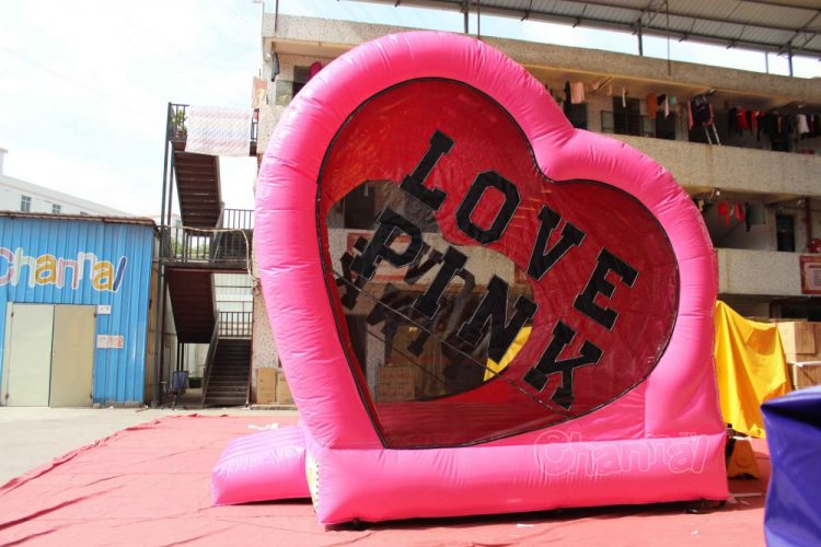 pink love themed bouncy castle for wedding