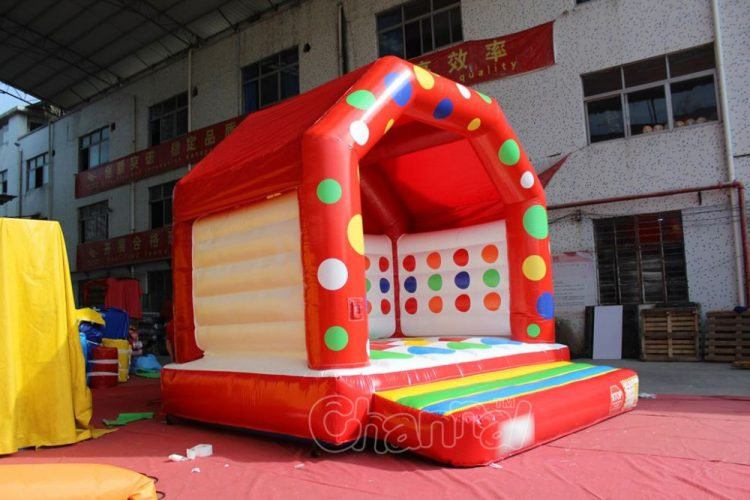 commercial bounce house with twister game