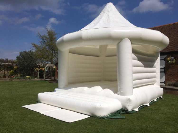 white bouncy house for wedding