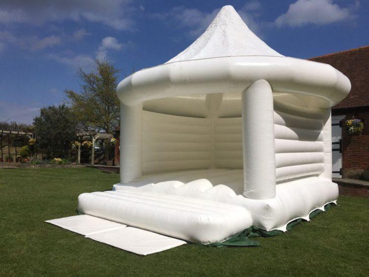 white bouncy house for wedding
