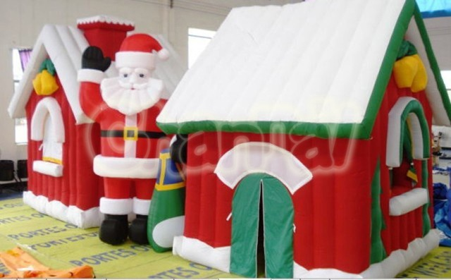 inflatable santa claus giving gifts
