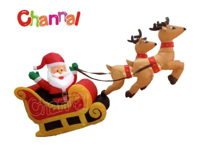 flying inflatable Santa Claus in reindeer sleigh