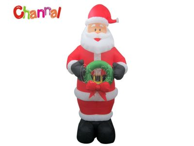 inflatable santa claus with garland