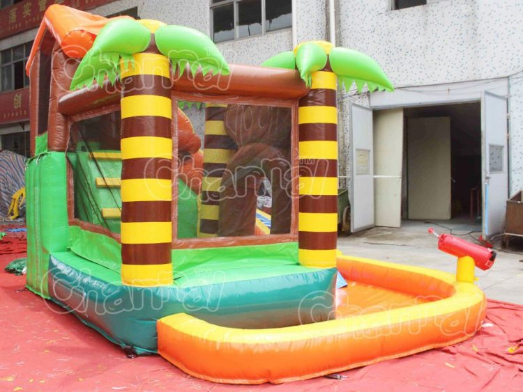 monkey themed bouncer with water pool