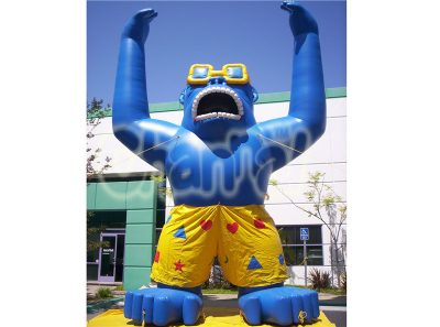 giant Inflatable Gorilla with cool sunglasses and board short