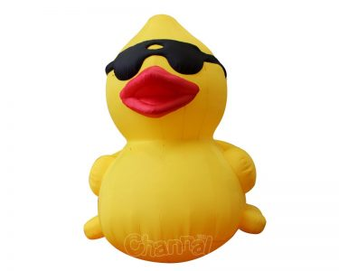 yellow giant inflatable duck with cool sunglasses