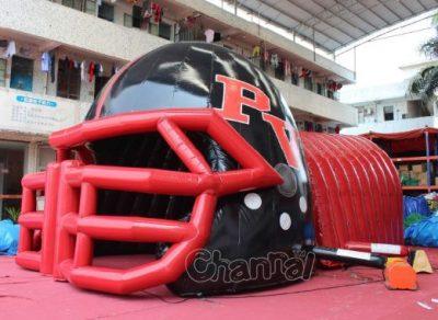 red football helmet tunnel for players entrance