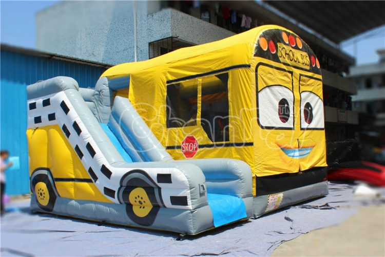 school bus bounce house with slide