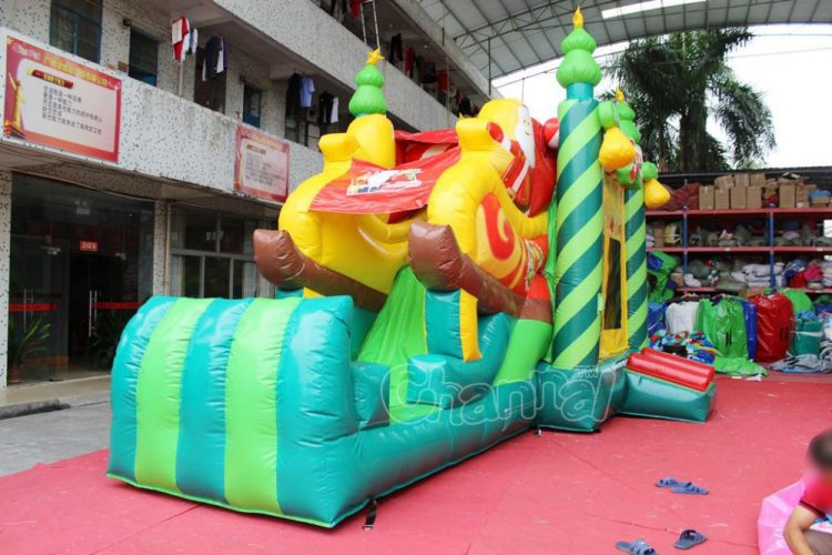 Christmas tree bounce house with slide