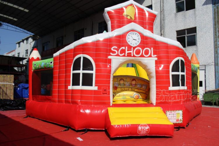 school house inflatable moon bounce