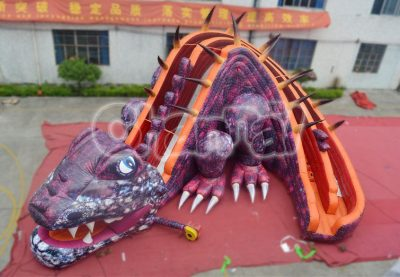 purple dinosaur inflatable slide