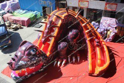 purple dinosaur inflatable slide
