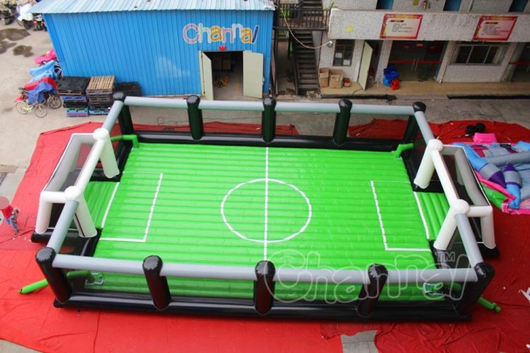 green blow up soccer arena with net
