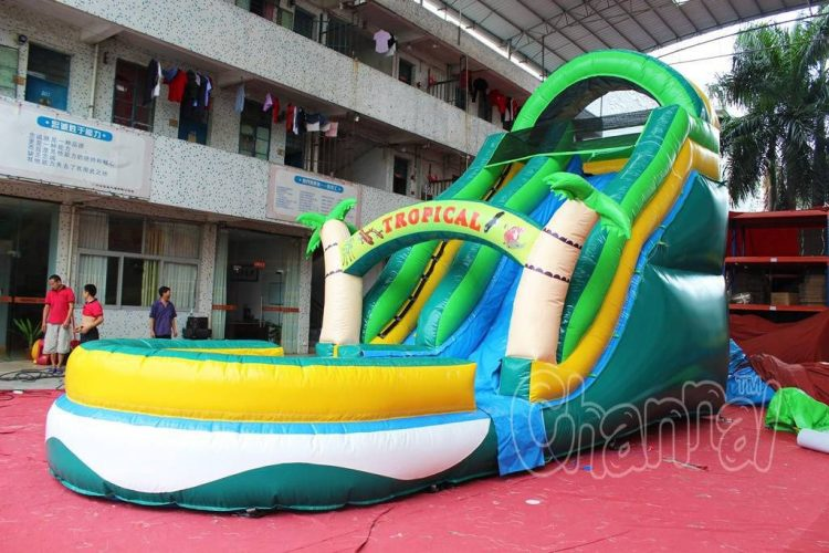 large tropical inflatable water slide with pool